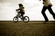 child ridding on a bike without training wheels