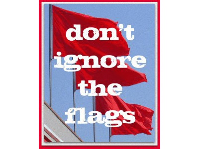 sign that says don't ignore the flags