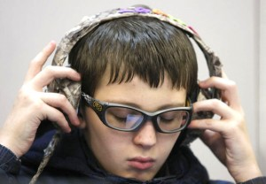 Student at Arcola Elementary listens to audiobooks.