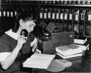 Black and White Photo of Volunteer Recording Book