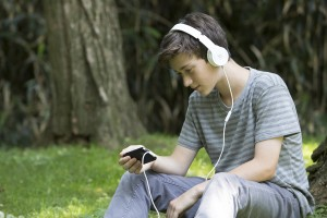 Teen Boy Ear Reading
