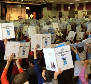 Kids Holding Up Books