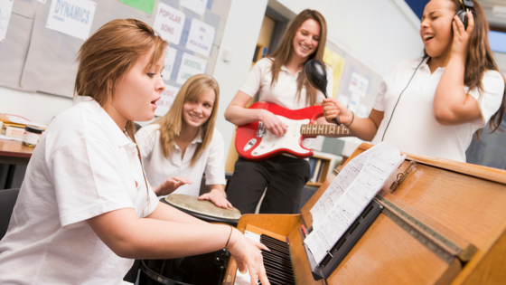 Happy Students Playing Music