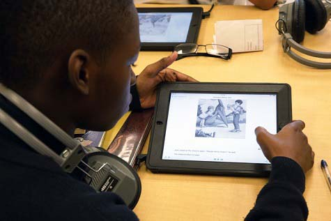 student-reading-with-tablet