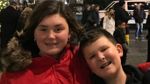 12yo girl with brother smiling
