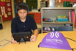Student using tablet to read audiobooks