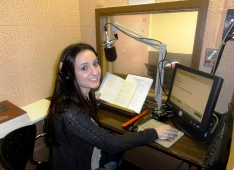 female volunteer recording audiobook in studio