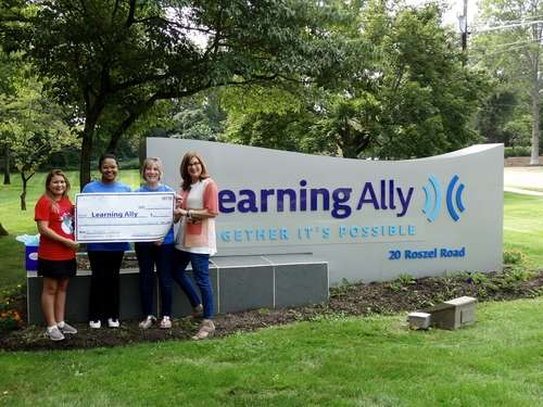 Learning Ally staff with donation from students