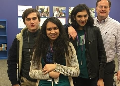 2 male and 2 female blind college students with mentor smiling at camera