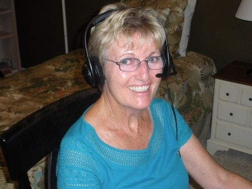 Volunteer in her home recording audiobook