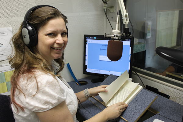 Deanna reading and recording an audiobook